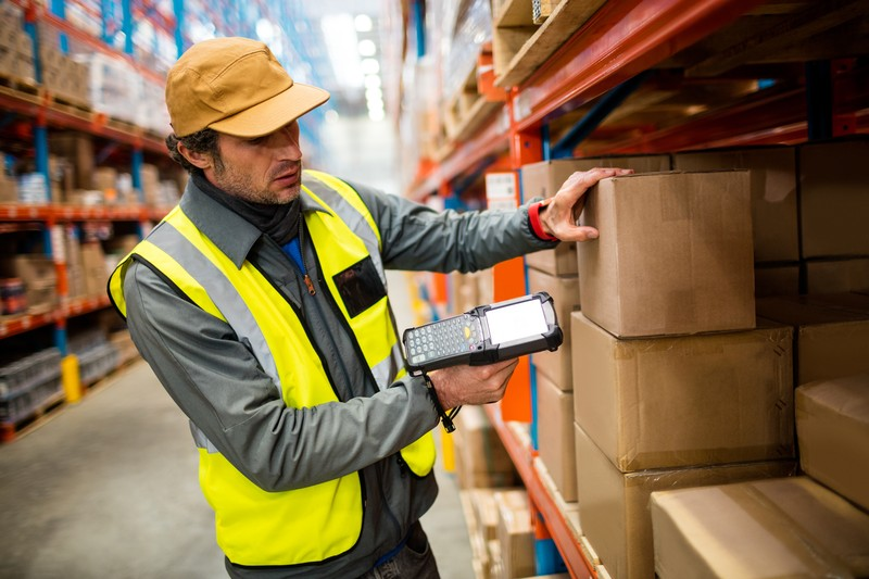 Warehouse worker using hand scanner in a warehouse, Image: 287921398, License: Royalty-free, Restrictions: , Model Release: yes, Credit line: Profimedia, Wavebreak